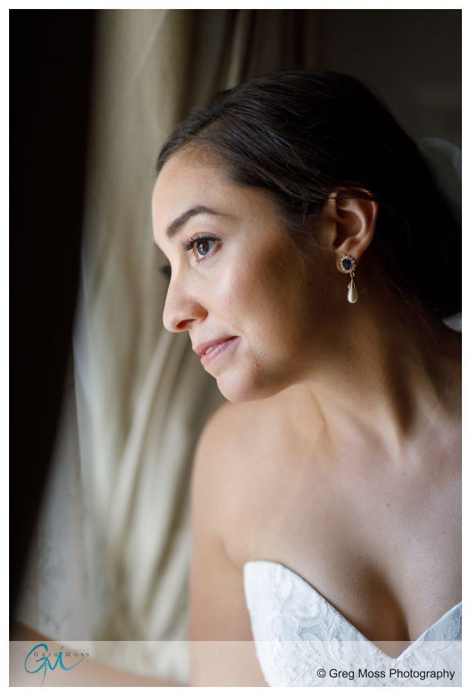 Bride looking through wedding waiting for wedding