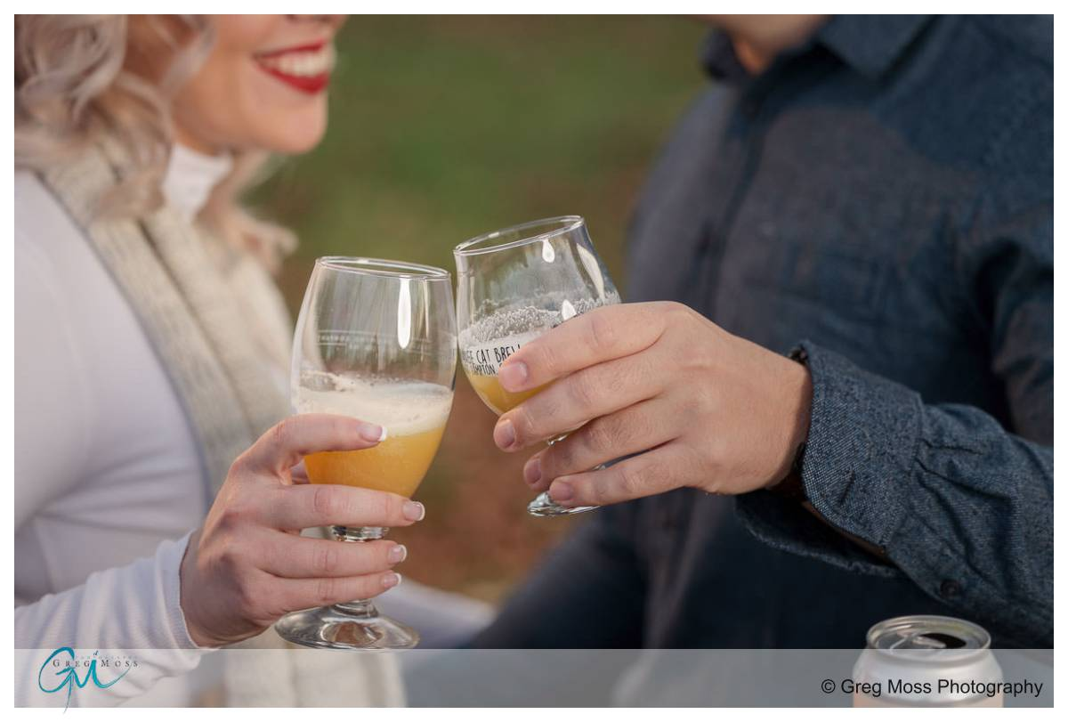 Engagement couple with beer glasses