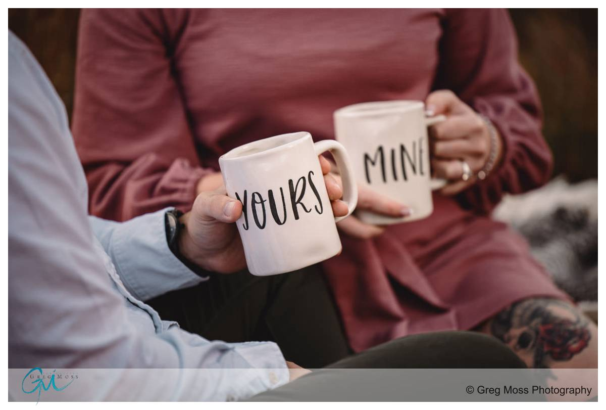 engagement couple with yours and mine coffee cups
