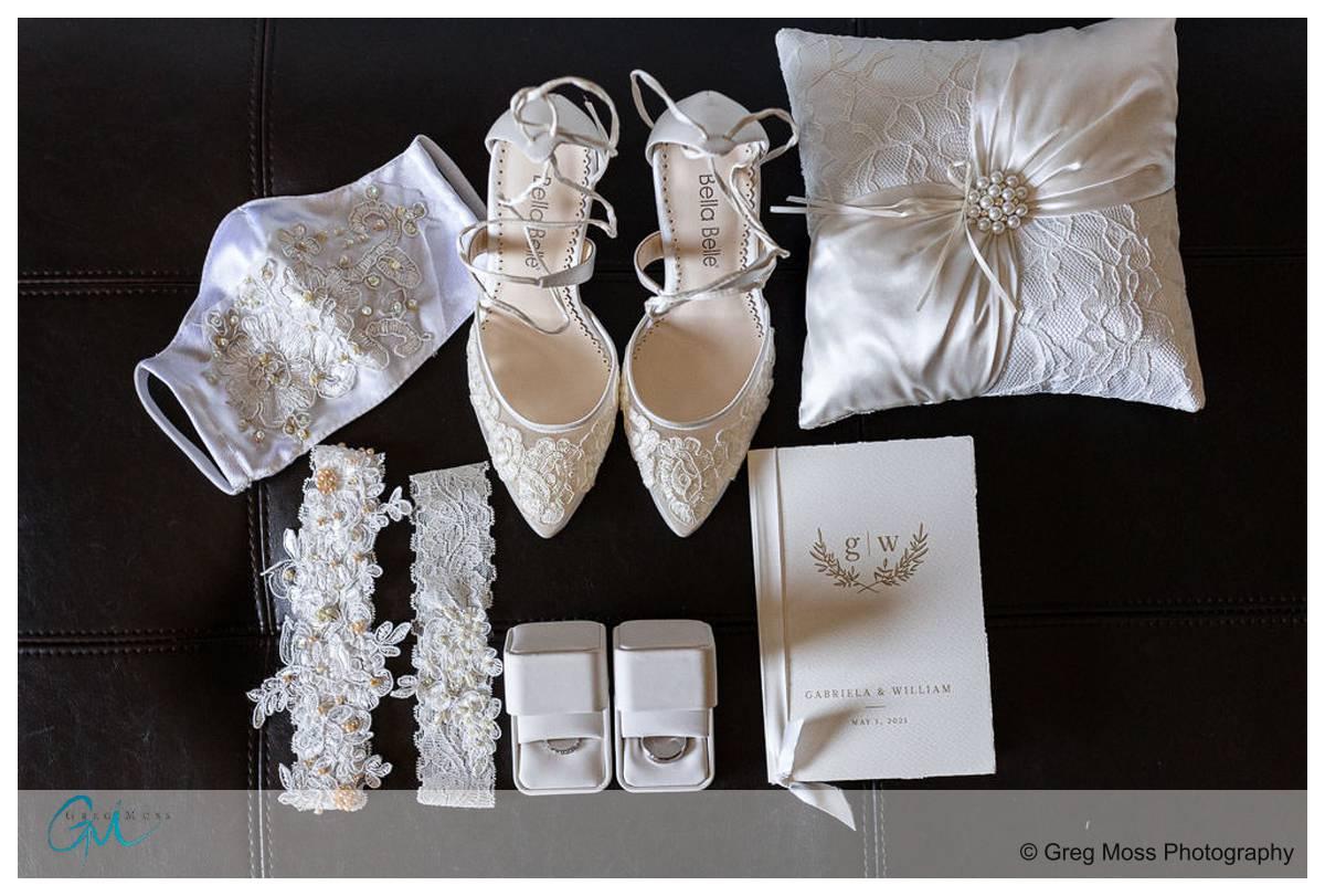 Bride's details including shoes, garter, rings,