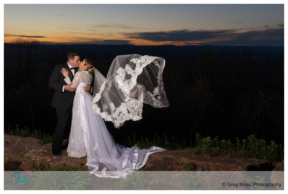 Wedding day sunset photo with Bride and Groom at the Log cabin in Holyoke