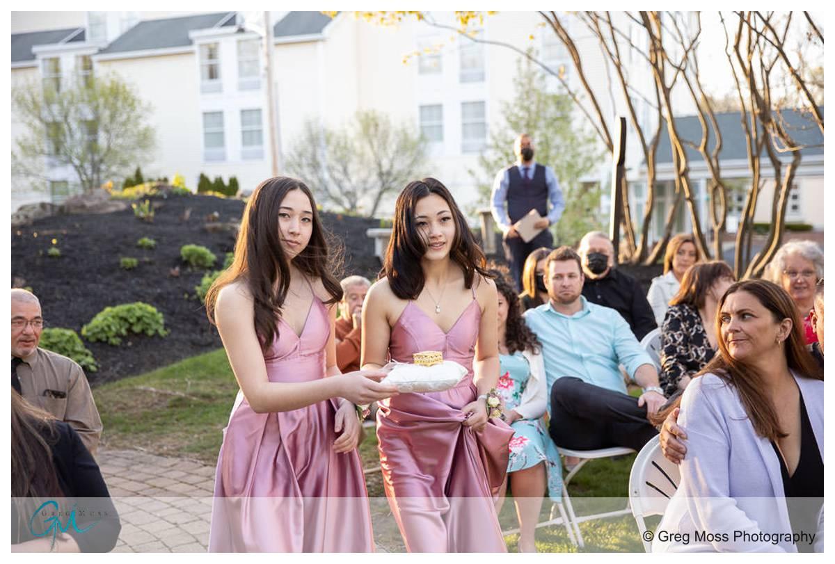 Groom's daughters bring rings to preist