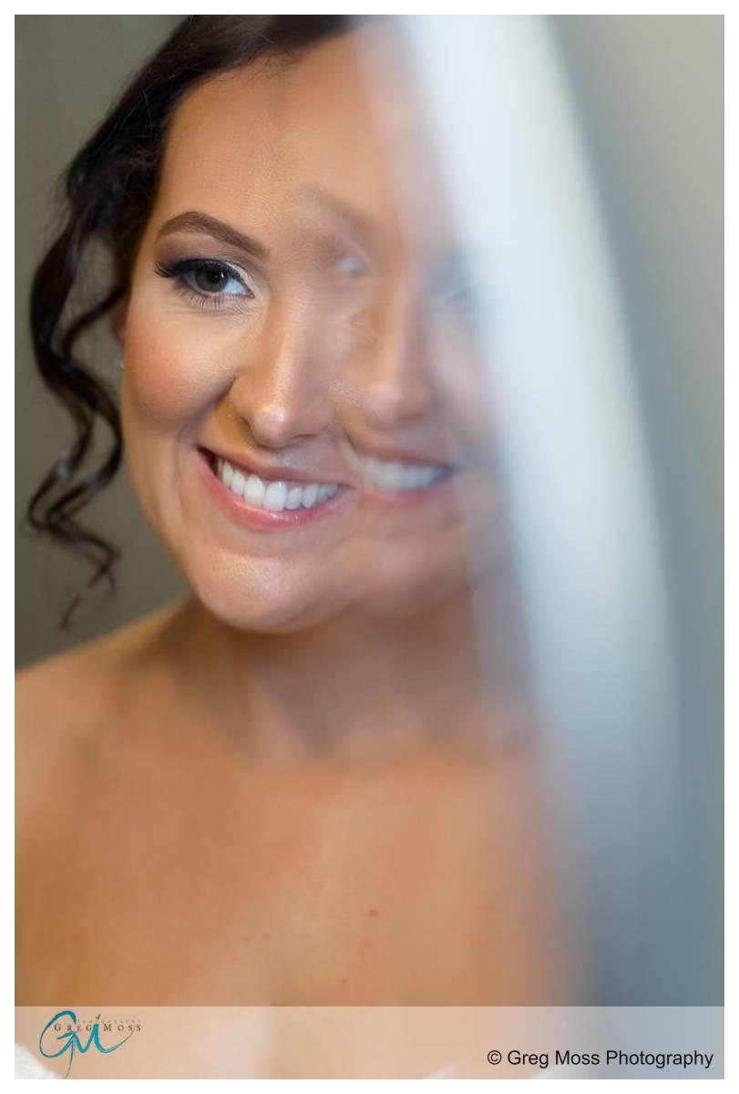 Portrait of bride in front of mirror