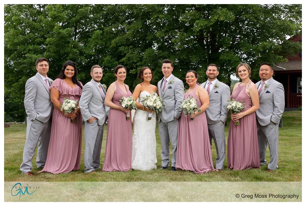 Wedding party in grassy field