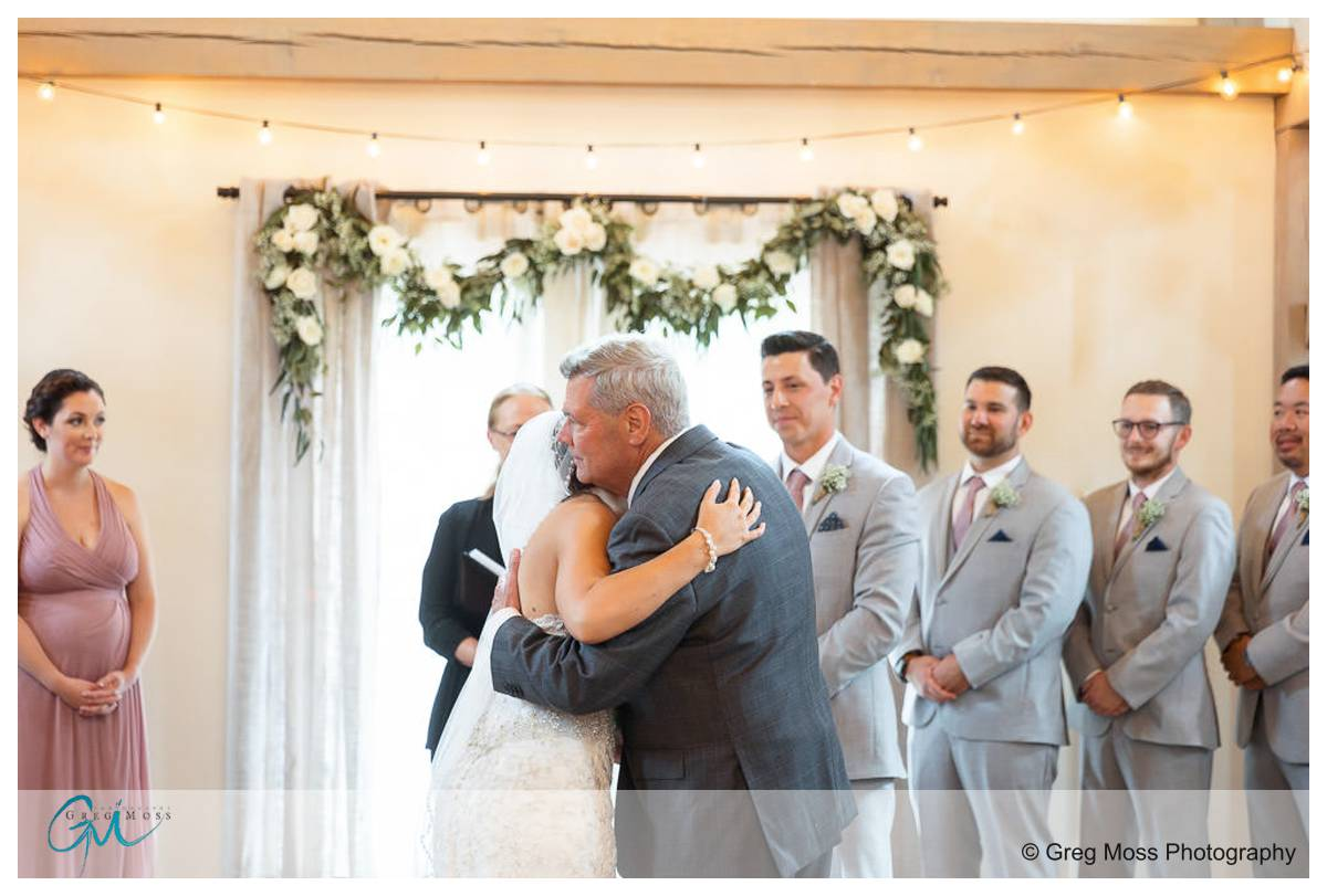 Dad giving bride away at beginning of ceremony