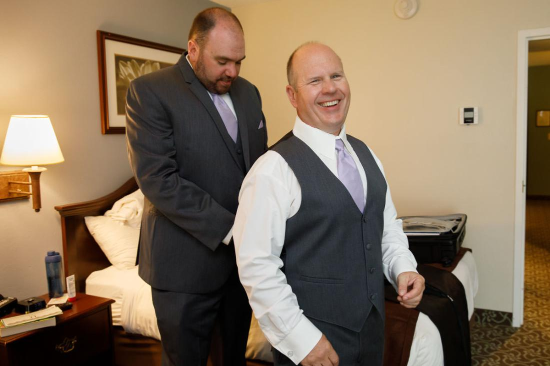 Groomsmen helping each other getting ready