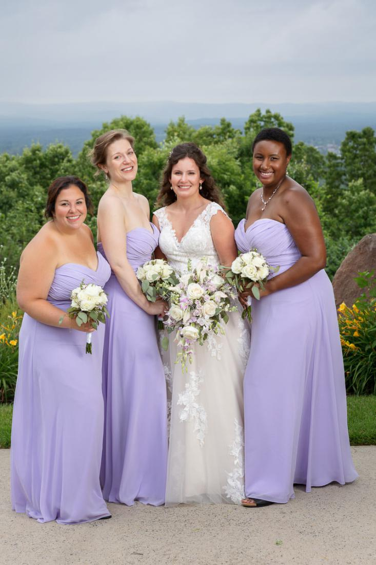Bridesmaids in lavender dresses with bride