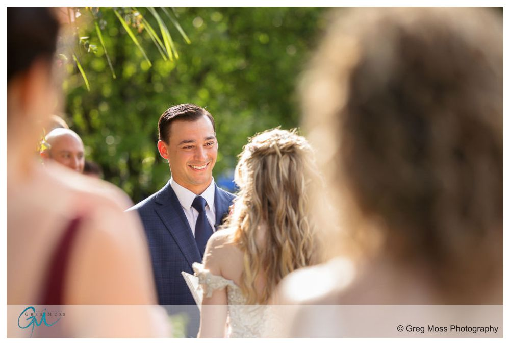 Groom smiling during ceremony
