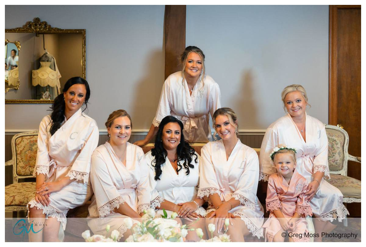 Bridal party in matching robes before ceremony