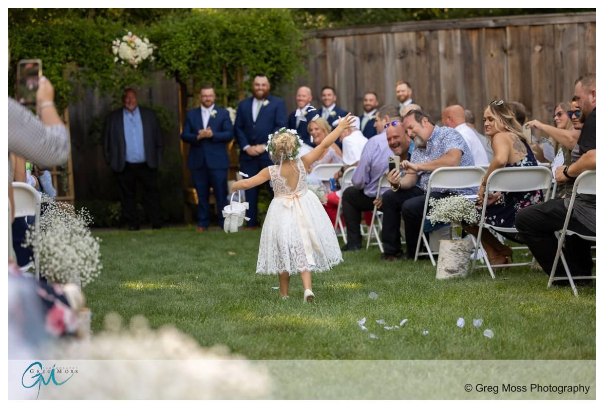 Flower girl throwing flowers