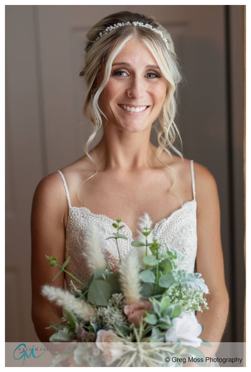 Bride with flowers on wedding day