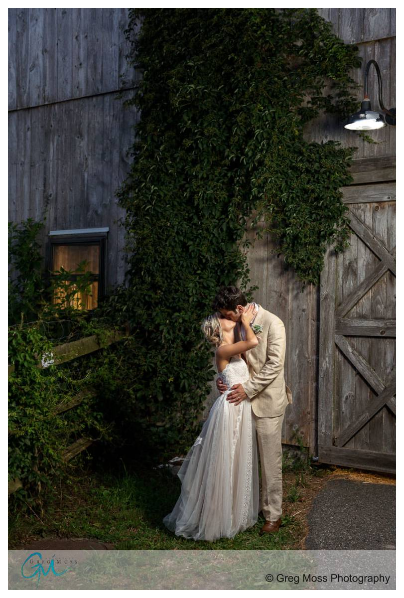 photo in front of barn at Plimouth Museum wedding