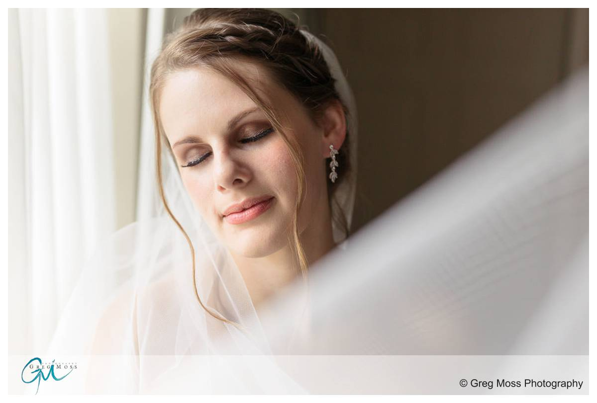 Bride with veil and window light