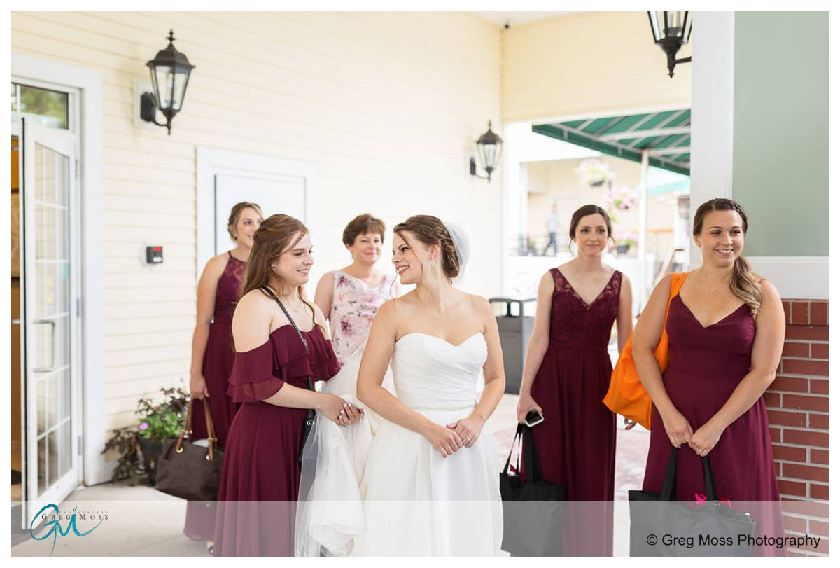 Bride and Bridesmaids getting on shuttle to go to Log Cabin