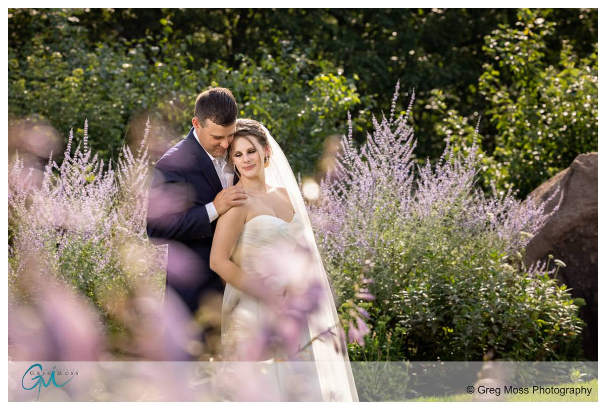 Bride and groom portrait in front of flowers