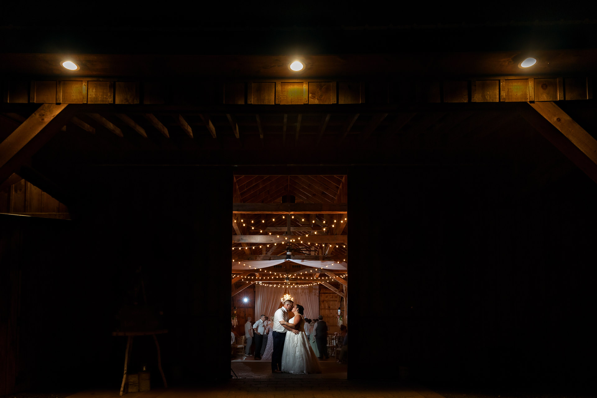 Bride and Groom in front of barn at Blissful Meadows GC