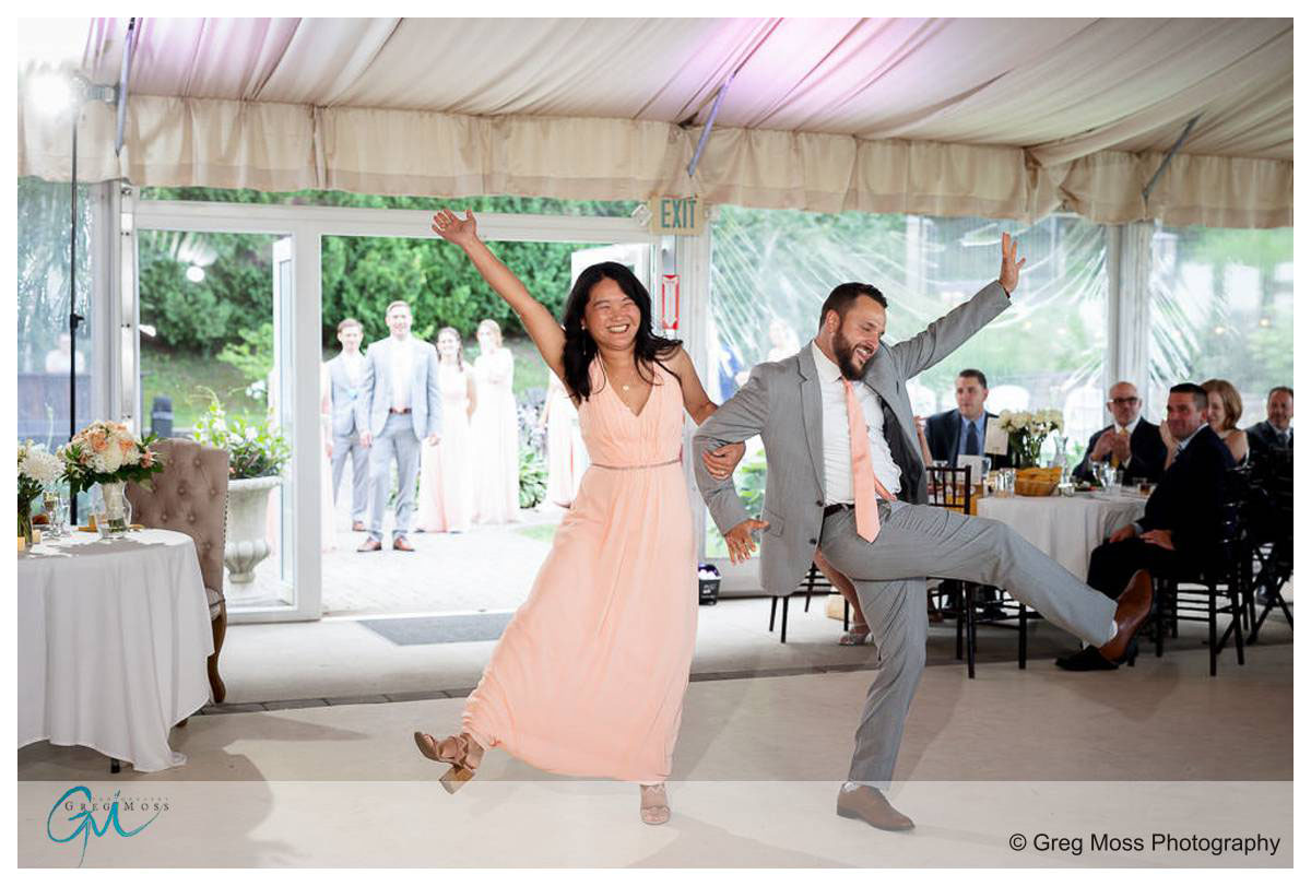 Bridesmaid and groomsmen introduction photo with legs and arms kicking