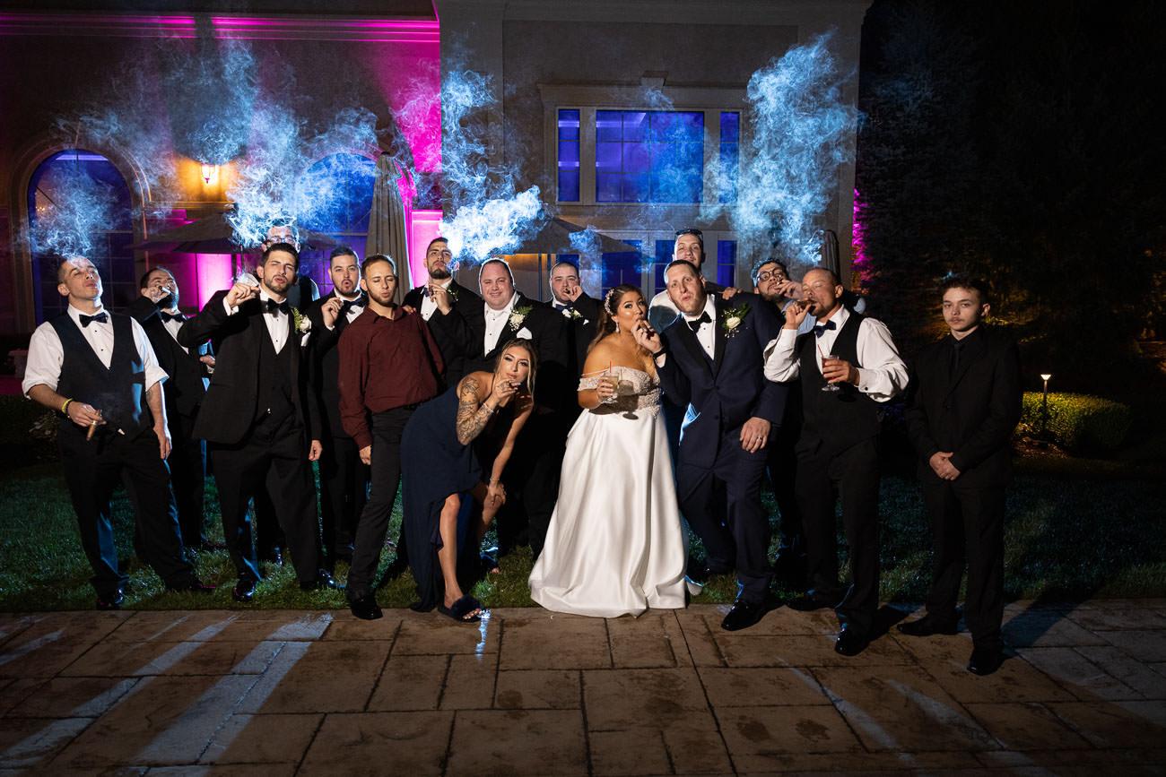 Bridal party and Bride and groom smoking cigars