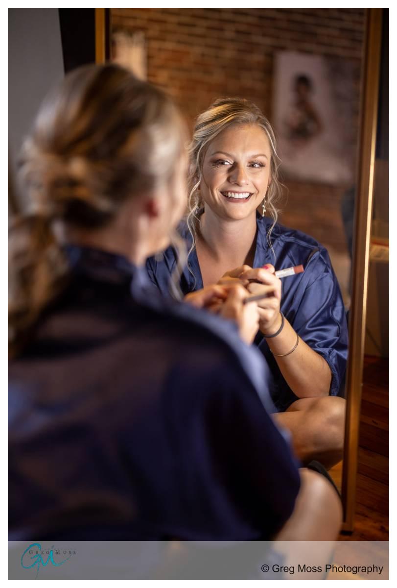 Bridesmaid finishing makeup