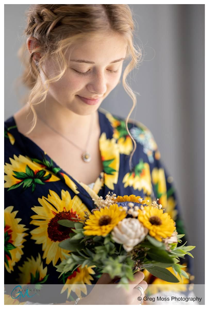 Flower Girl in Sunflower robe and sunflowers boquet