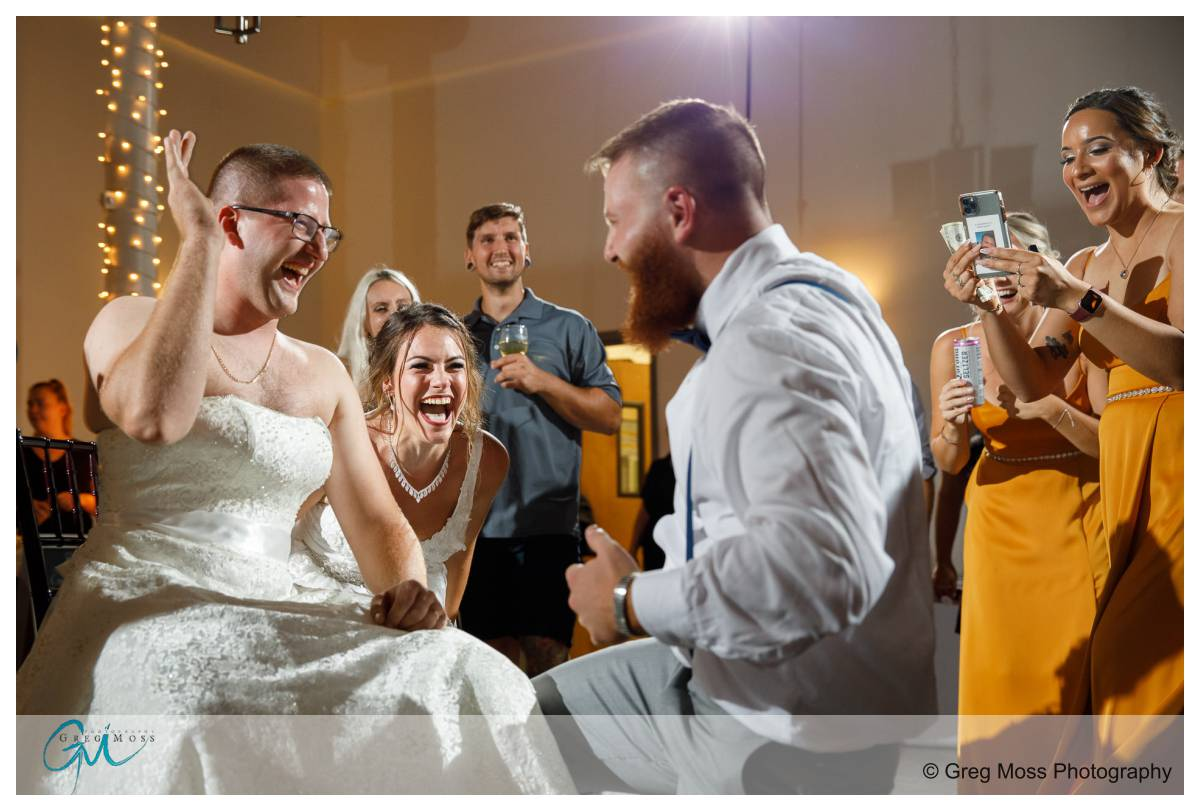 Brother of the groom dressed up as bride for garter retrieval