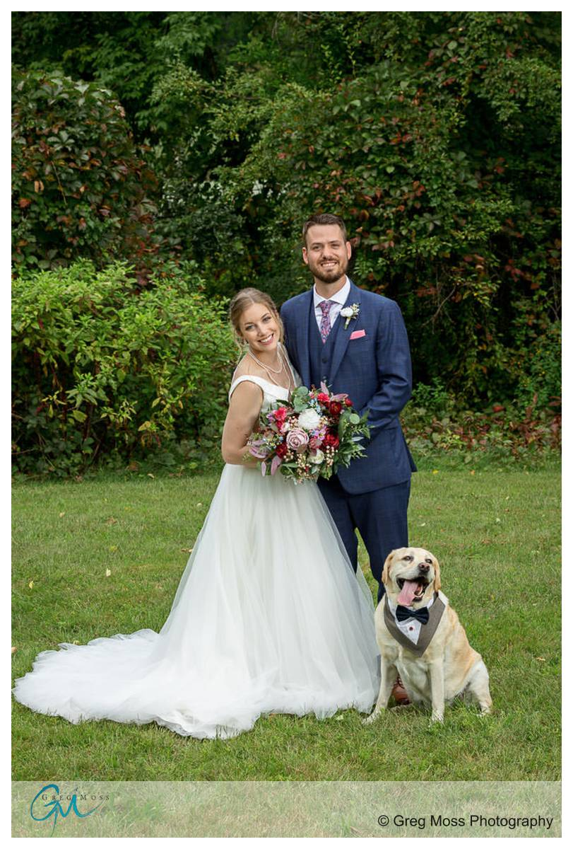 Wedding couple with their dog
