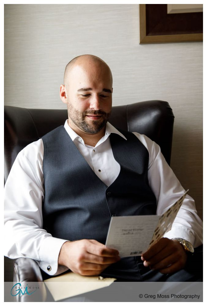 Groom reading letter from bride on the day of the wedding