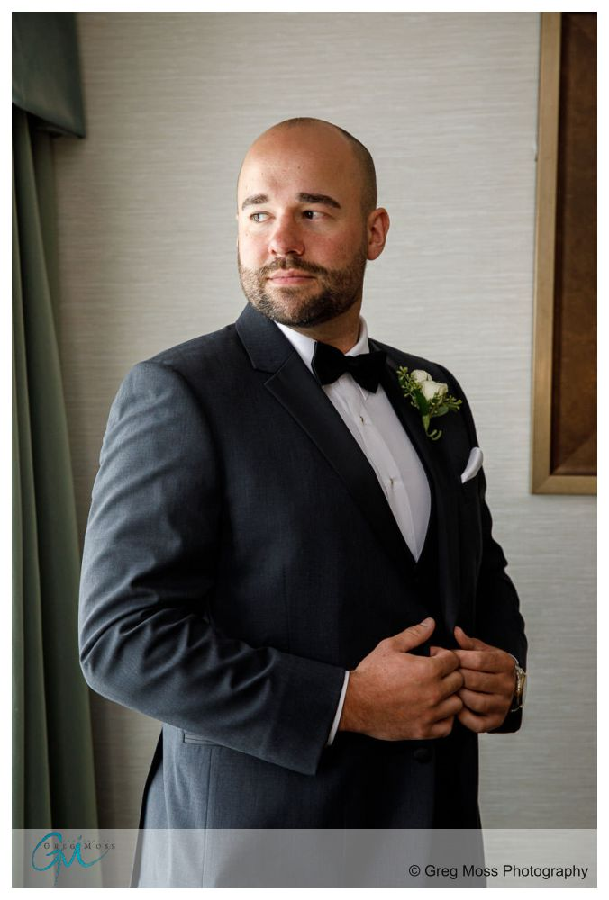 Groom window portrait at the D Hotel in Holyoke