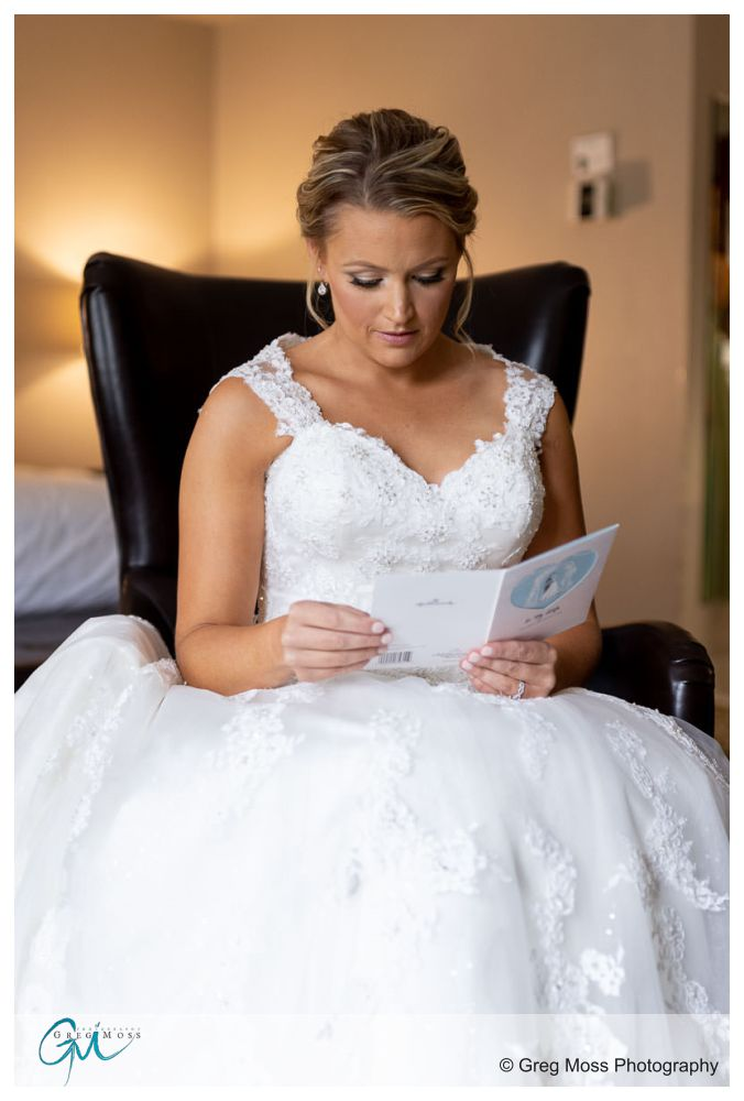 Bride reading letter day of Wedding from Groom